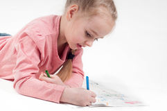 Drawing little girl in pink Stock Images