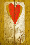 Drawing love symbol on old wooden wall Royalty Free Stock Photo