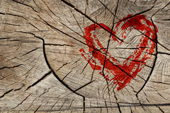 Drawing love symbol on wooden wall Royalty Free Stock Photography