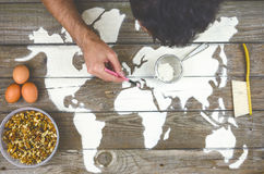 Drawing maps of the world with flour Royalty Free Stock Photo