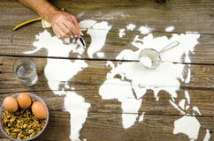 Drawing maps of the world with flour Stock Photography