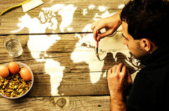 Drawing maps of the world with flour Royalty Free Stock Photos