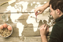 Drawing maps of the world with flour Stock Photos
