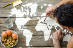 Drawing maps of the world with flour Royalty Free Stock Image