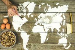 Drawing maps of the world with flour Stock Image