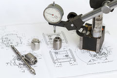 Drawing and measuring tools. Micrometer and machine parts in the drawing Stock Images