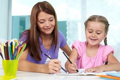 Drawing with mom Stock Photo