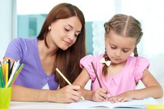 Drawing with mom Stock Photos