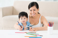 Drawing with mom Stock Images