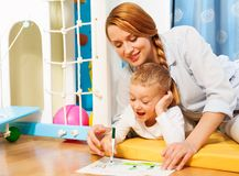 Drawing with mommy Royalty Free Stock Photography