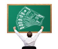 Drawing money on desk Stock Photo