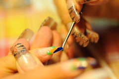 Drawing on a nail royalty free stock image