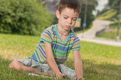 Drawing outdoors boy Stock Photography