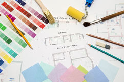 Drawing with paintbrush, color sample and working tools Royalty Free Stock Photography