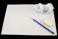 Drawing paper with pencil. Rubber and two crumpled paper balls royalty free illustration