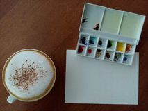 drawing paper with watercolor plate and hot coffee Royalty Free Stock Images