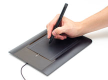 Drawing with a pen on a tablet. A hand holding a pen stylus and drawing on a tablet Stock Images