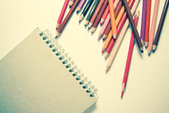 Drawing with pencils. Drawing art concept: background with color pencils and notebook for drawing Royalty Free Stock Images