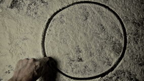 Drawing pentagram into dust with thunderstrike stock footage