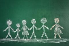 Drawing of people holding hands together. On chalkboard. Unity concept Royalty Free Stock Photography