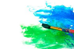 Drawing a picture with paintbrush Stock Photography