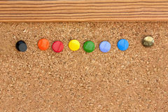 Drawing pins in a cork pinboard Royalty Free Stock Images
