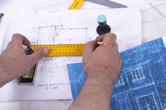 Drawing Plans. A draughtsman / architect working on his floor plan Stock Photos