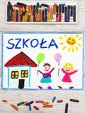 Drawing: Polish word SCHOOL, school building and happy children stock photos