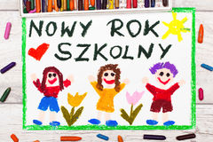 Drawing: Polish words NEW SCHOOL YEAR and happy children. Photo of  colorful drawing: Polish words NEW SCHOOL YEAR and happy children. First day at school Stock Photos