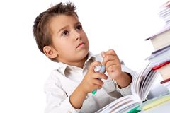 During drawing. Portrait of smart school boy with highlighter thinking what to draw Royalty Free Stock Photo