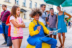 Drawing  portraits in Arbat street of Moscow. Russia, on Sunday, July 20, 2014. Vakhtangov Theatre and fountain Turandot in Arbat street of Moscow, Russia, on Stock Image