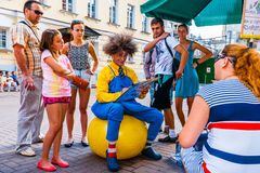 Drawing  portraits in Arbat street of Moscow. Russia, on Sunday, July 20, 2014. Vakhtangov Theatre and fountain Turandot in Arbat street of Moscow, Russia, on Stock Photography