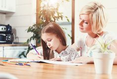 Mother And Daughter Drawing Toogether royalty free stock images
