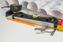 Drawing rolls and construction tools composition Royalty Free Stock Images