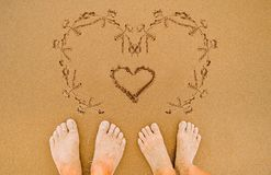 Drawing romantic Love heart on beach Stock Images