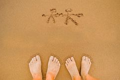 Draw Romantic Lover feet in Valentines Day. Drawing romantic Love heart and lover on beach and lover feet Royalty Free Stock Photography