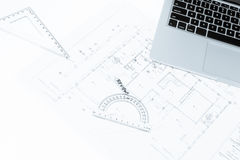 Drawing rulers, and notebook over house construction blueprint  Stock Image