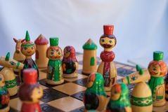 Close-up of king with other pawns on the chessboard. Drawing russian king pawn during a chess match stock photography