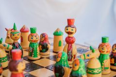 Close-up of king with pawns on the chessboard. Drawing russian king pawn during a chess match royalty free stock images