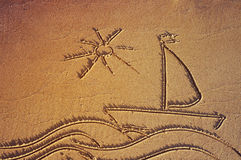 Drawing of a sailing vessel in the sea with the sun on sea sand on the beach. Royalty Free Stock Images