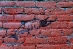 Drawing of salmon on brick wall. Street art (or graffiti) on a wall in an alley in Bend, Oregon, in the Pacific Northwest, where many runs of salmon have been Royalty Free Stock Images