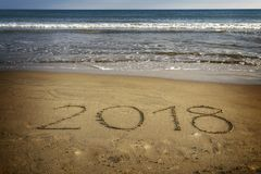 Drawing 2018 on the sand Stock Images