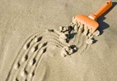 Drawing on the sand. Made by toy rake Royalty Free Stock Image