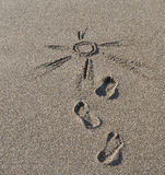 Drawing on sand. The sun which is drawn on sea sand Stock Images