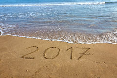 Drawing 2017 on the sand Royalty Free Stock Photos