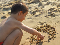 Drawing in the sand Royalty Free Stock Images