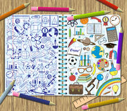 Drawing school items on a sheets of exercise book background. School items doodles on a sheets of exercise book background Stock Images