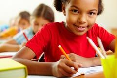 Drawing schoolgirl stock image