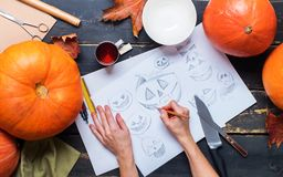 Drawing sketch character with hands pumpkin knife Stock Images
