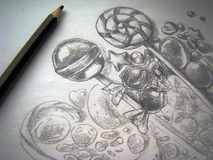 Drawing a sketch. Close up photo of a pencil and an unfinished sketch of candy still life Royalty Free Stock Photo